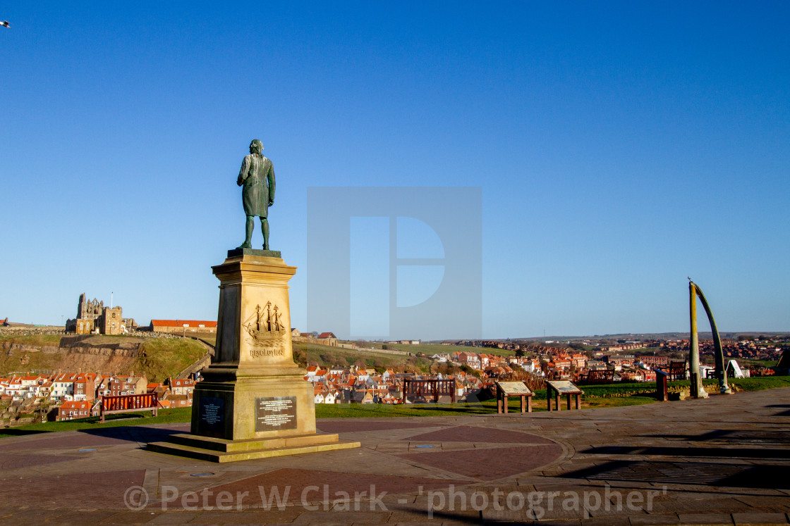 """Whitby,UK,Yorkshire,East coast, Monuments, Captain Cook Statue and the Whalebone Arch. Whitby Abbey in the Background"" stock image"