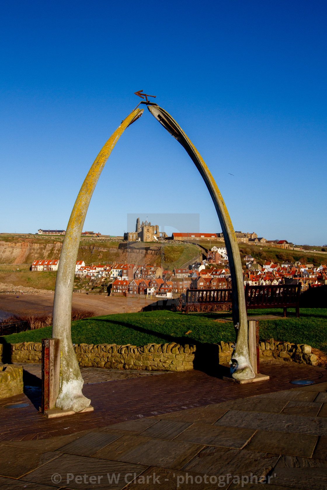 """Whitby,UK,Yorkshire,East coast, Monuments, the Whalebone Arch. Whitby Abbey in the background."" stock image"