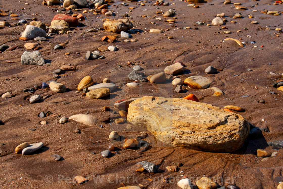 """Whitby, UK, Yorkshire East Coast, Pebble Assortment and Small Rock on the Beach"" stock image"