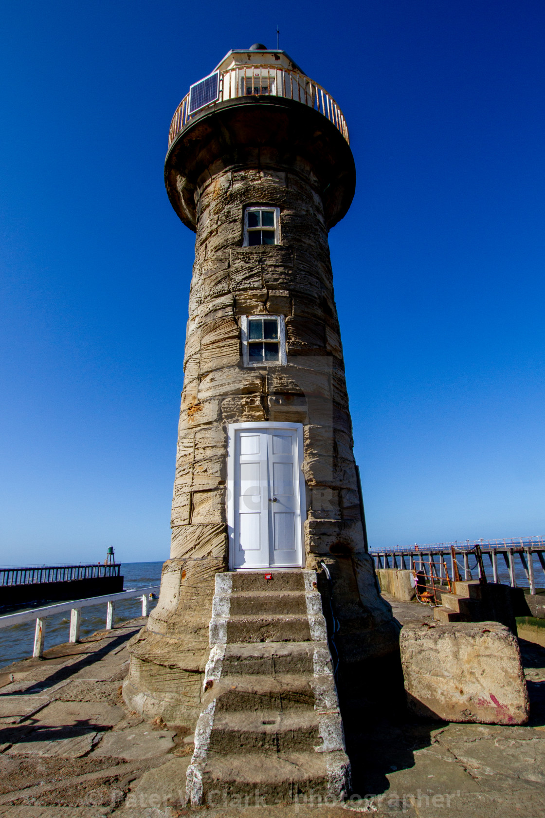 """Whitby,UK,Yorkshire,East coast, East Pier Old Lighthouse."" stock image"
