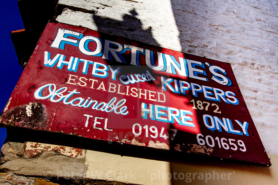 """Whitby,UK,Yorkshire,East coast, Fortunes Whitby Kippers Sign."" stock image"