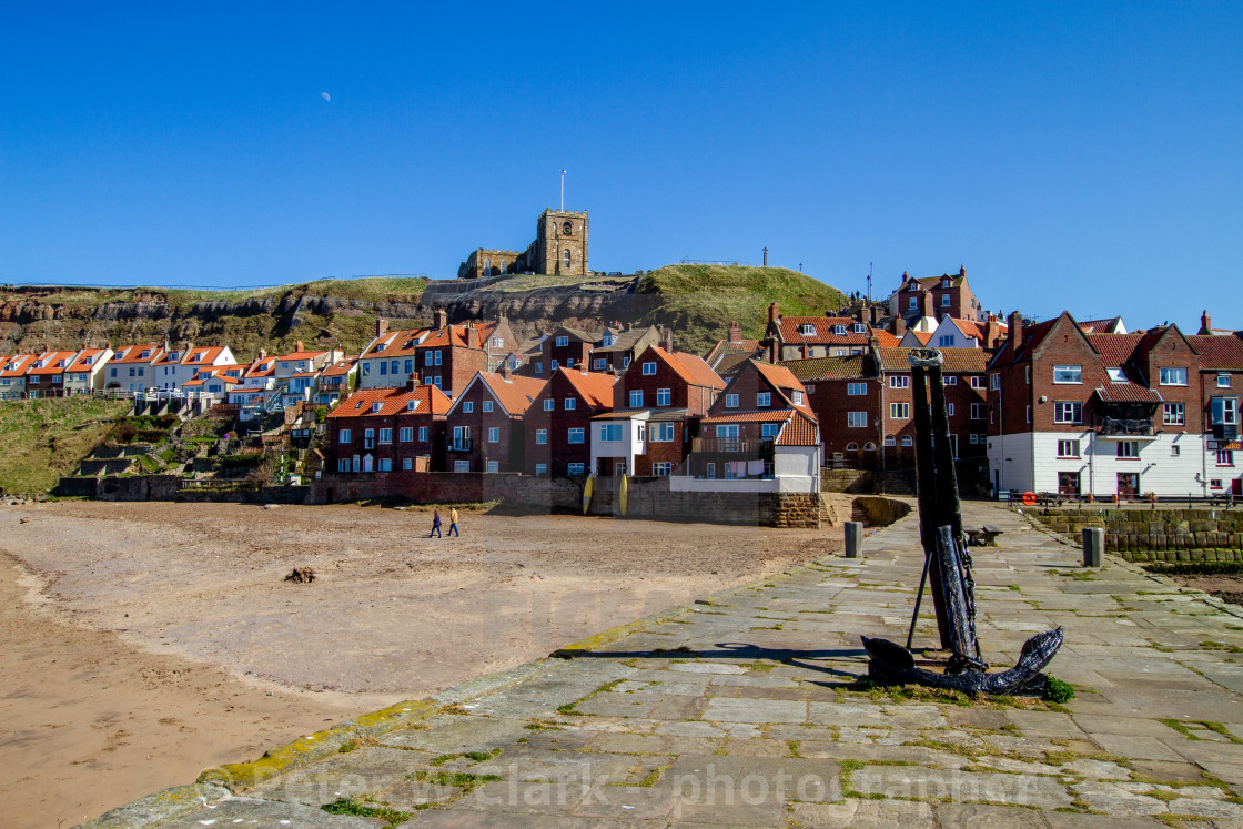 """Whitby,UK,Yorkshire,East coast, Old Anchor on Tate Hill Pier. St Mary's Church in the Background."" stock image"