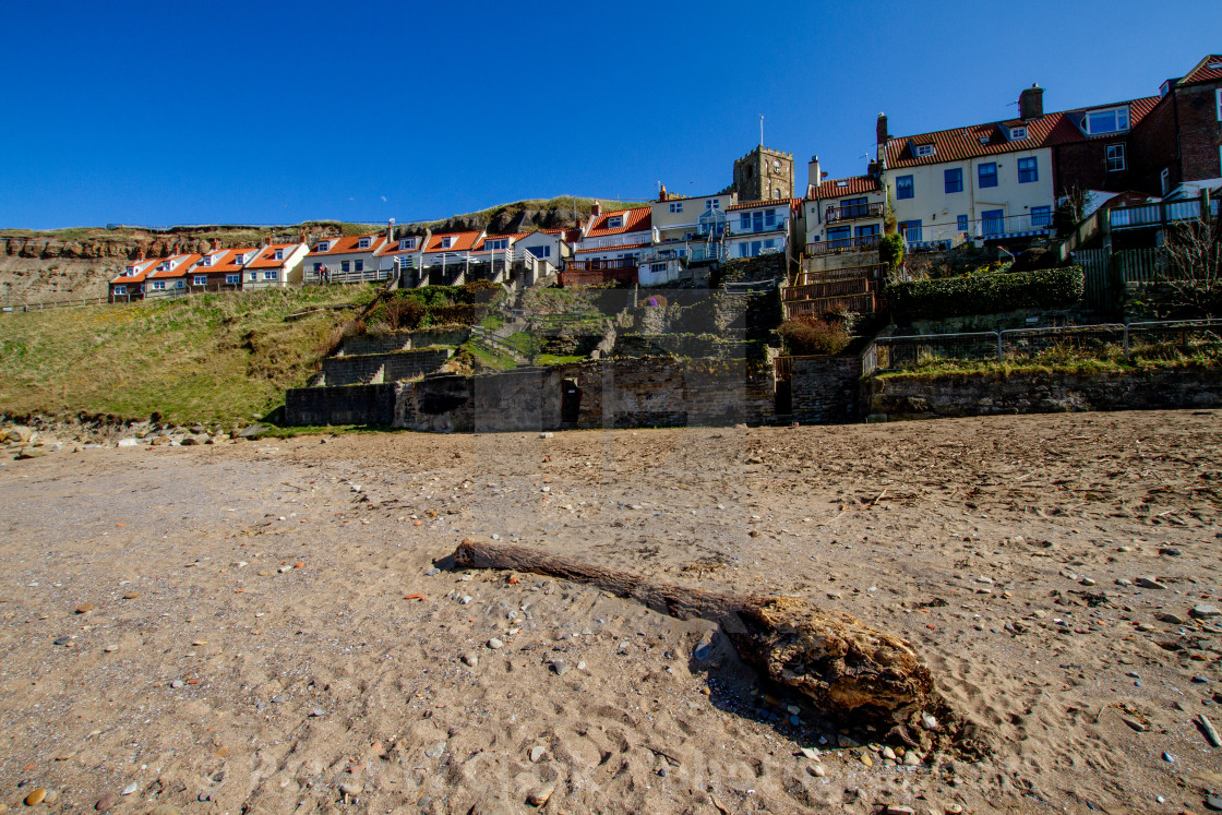 """Whitby,UK,Yorkshire,East coast, Collier Hope Beach and Driftwood, Tiered Gardens and St Mary's Church in the Background. Photographed April 2013."" stock image"