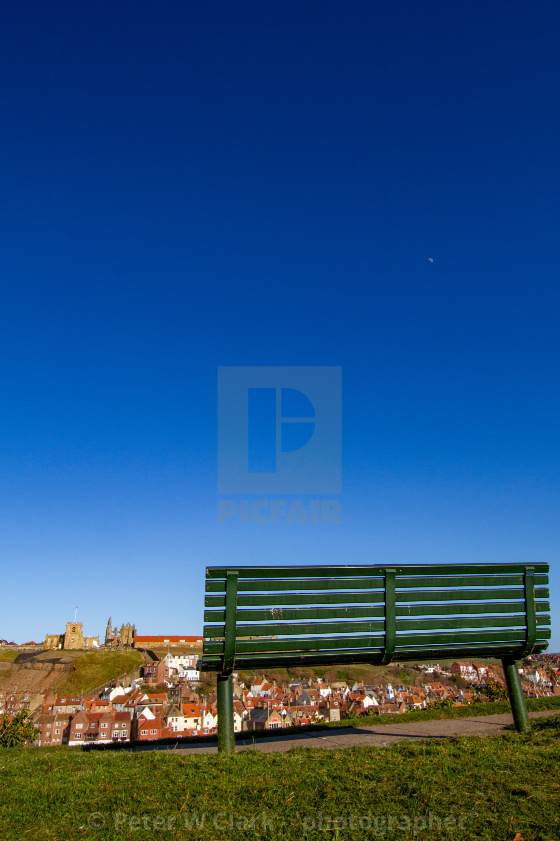 """Whitby,UK,Yorkshire,East coast, Best Viewing Seat in Whitby Overlooking the Khyber Pass, Harbour, Abbey and St Mary's Church."" stock image"