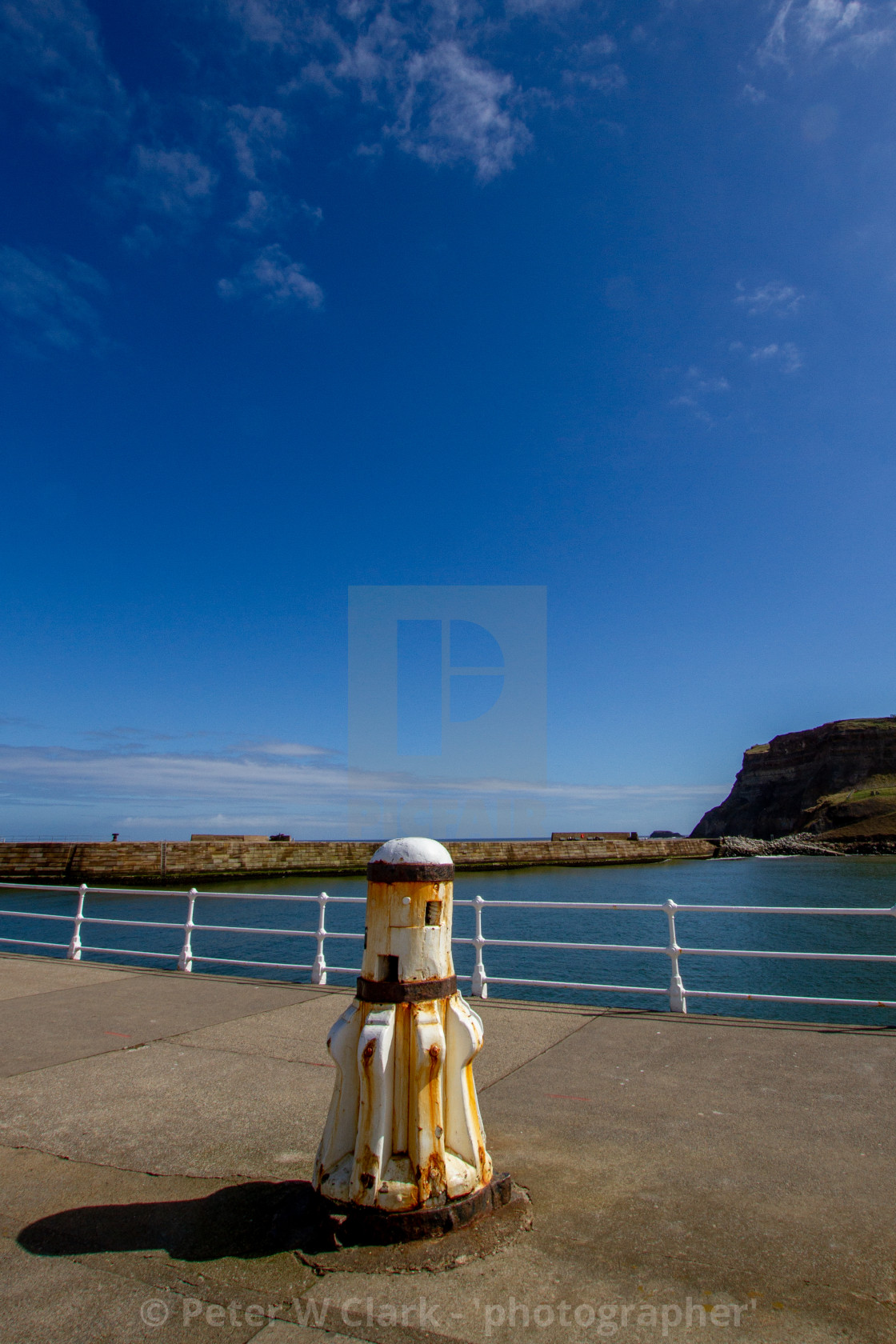 """Whitby,UK,Yorkshire,East coast, White Capstan on the Harbour Wall"" stock image"