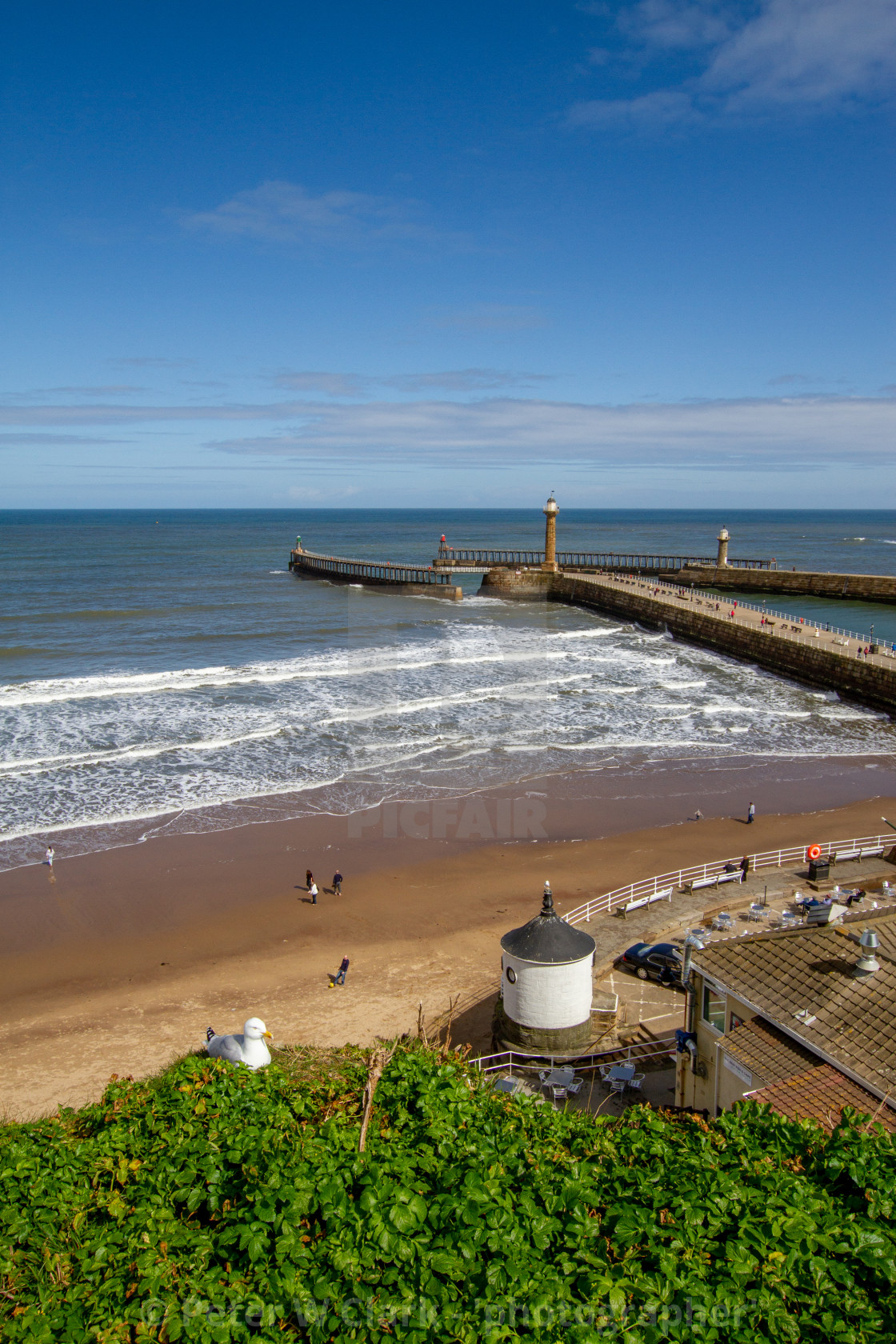 """Whitby,UK,Yorkshire,East coast,View from First Nab over East and West Piers, Harbour Entrance."" stock image"