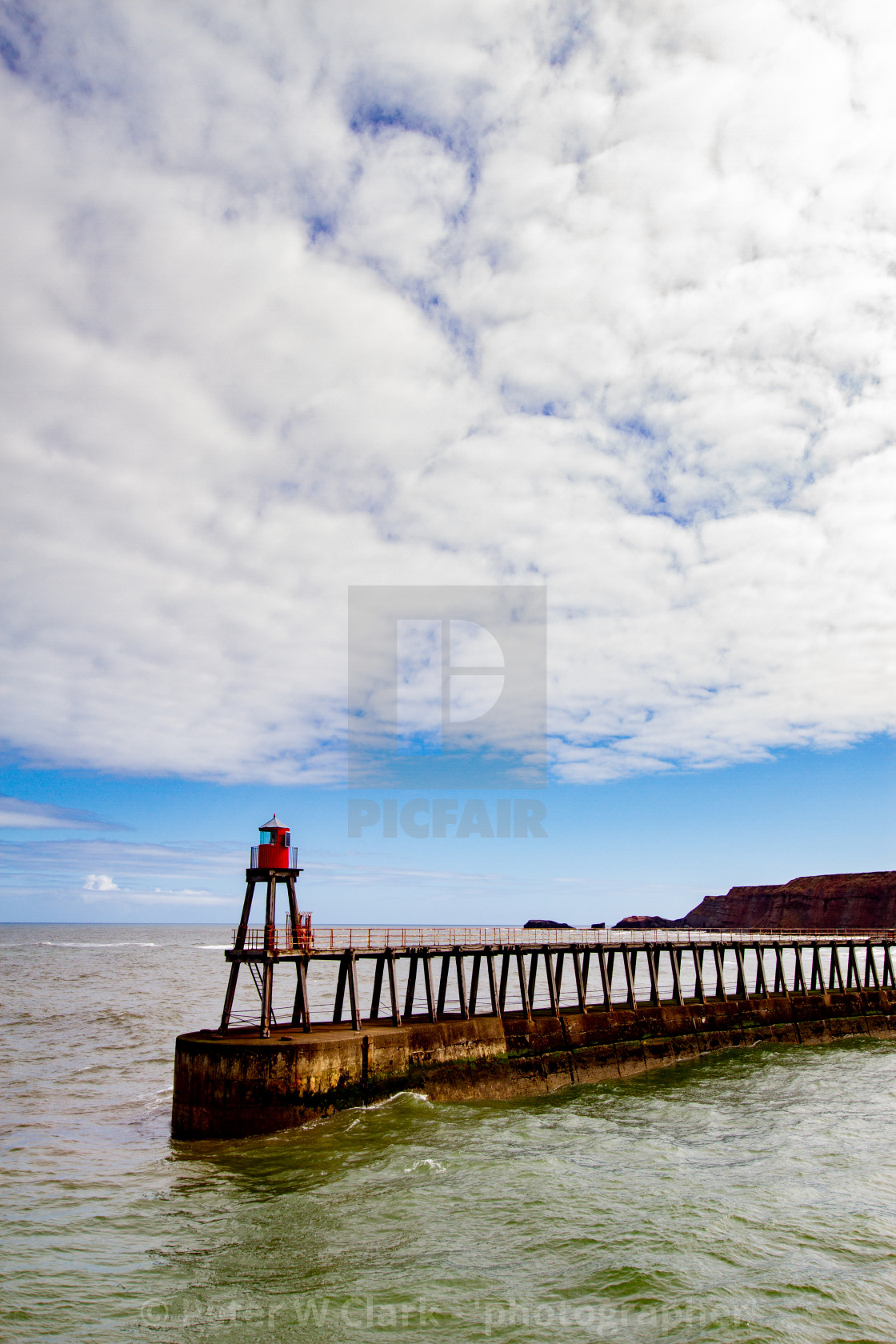 """Whitby,UK,Yorkshire,East coast, East Pier Breakwater and Harbour Light."" stock image"