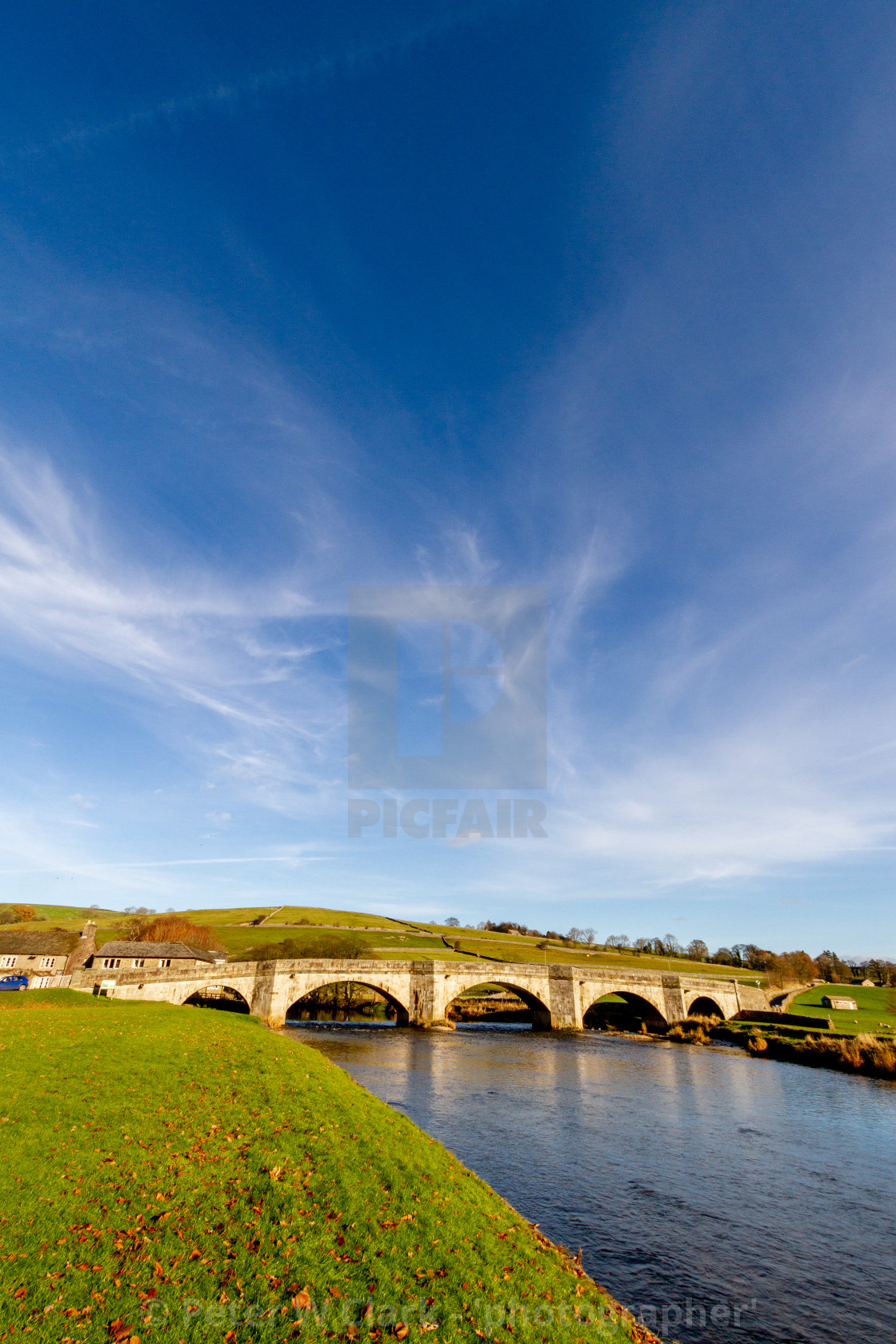 """Burnsall, Yorkshire Dales Village, England, Arched Stone Bridge over the River Wharfe"" stock image"