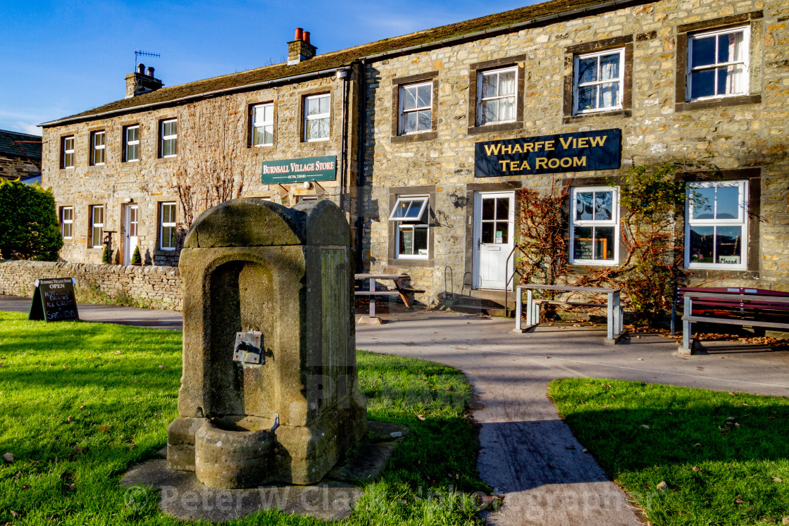 """""""Burnsall, Yorkshire Dales Village, England, Water Compensation Tap Housed in Carved Stone Surround on the Village Green"""" stock image"""