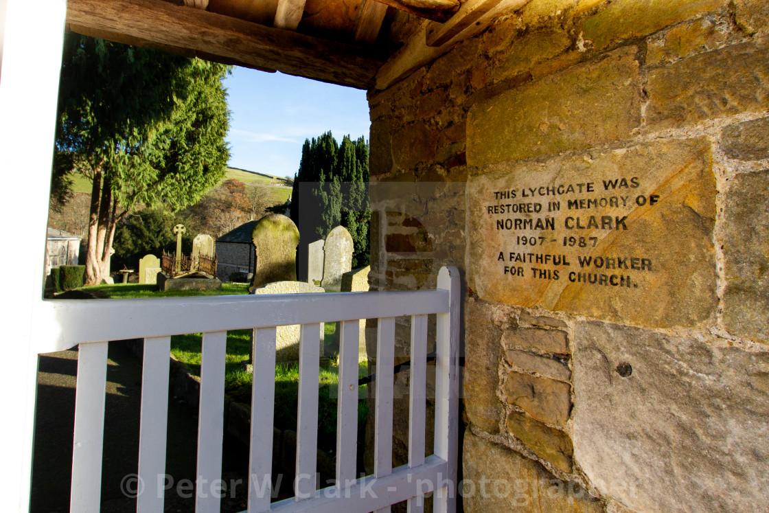 """Burnsall, Yorkshire Dales Village, England, St Wilfrids Parish Church. Burnsall, Yorkshire Dales Village, England, Entrance, Engraved Dedication Stone lych gates corpse gates"" stock image"