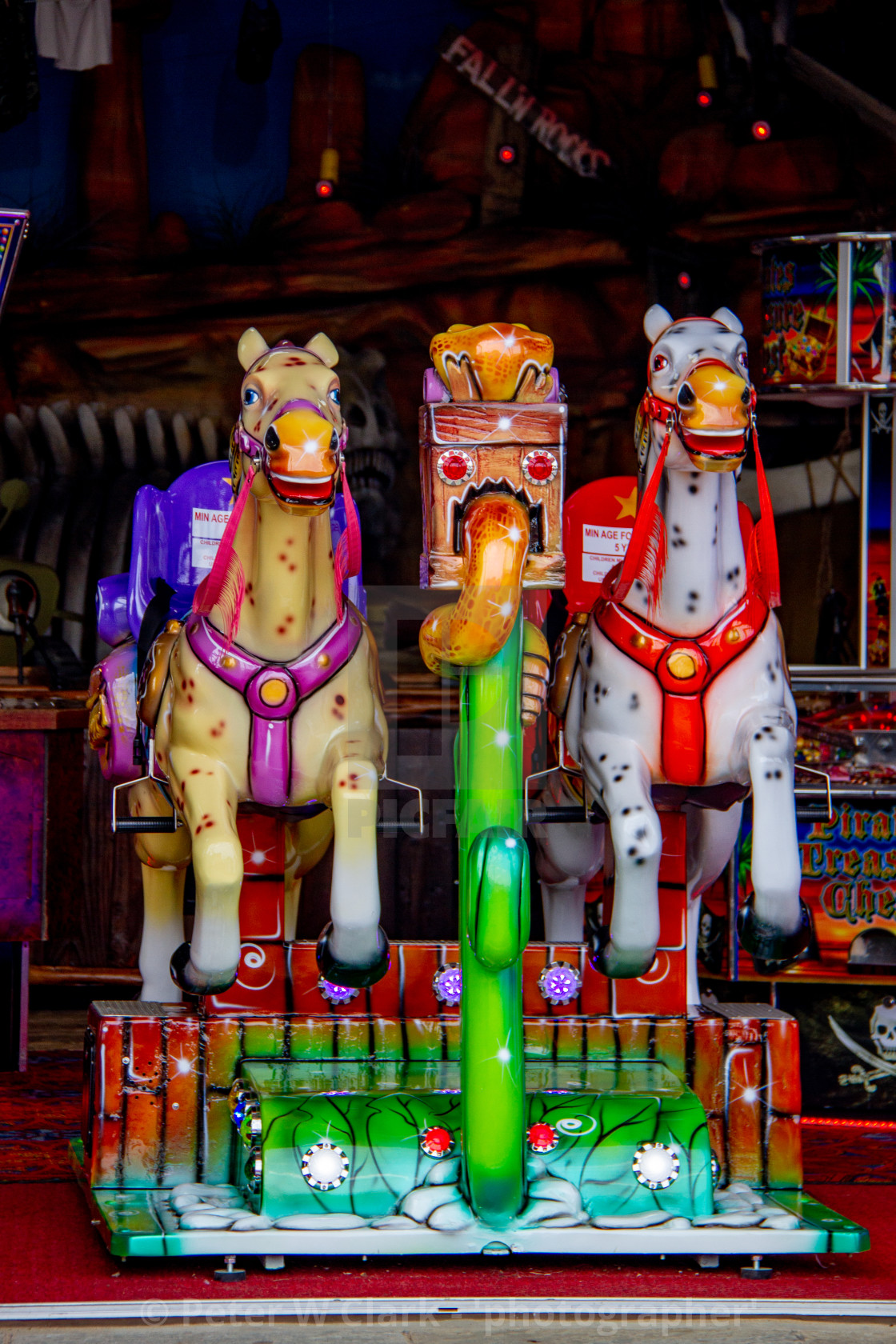 """Colourful Coin Operated Horse Ride in Whitby Amusement Arcade on Yorkshire East Coast."" stock image"