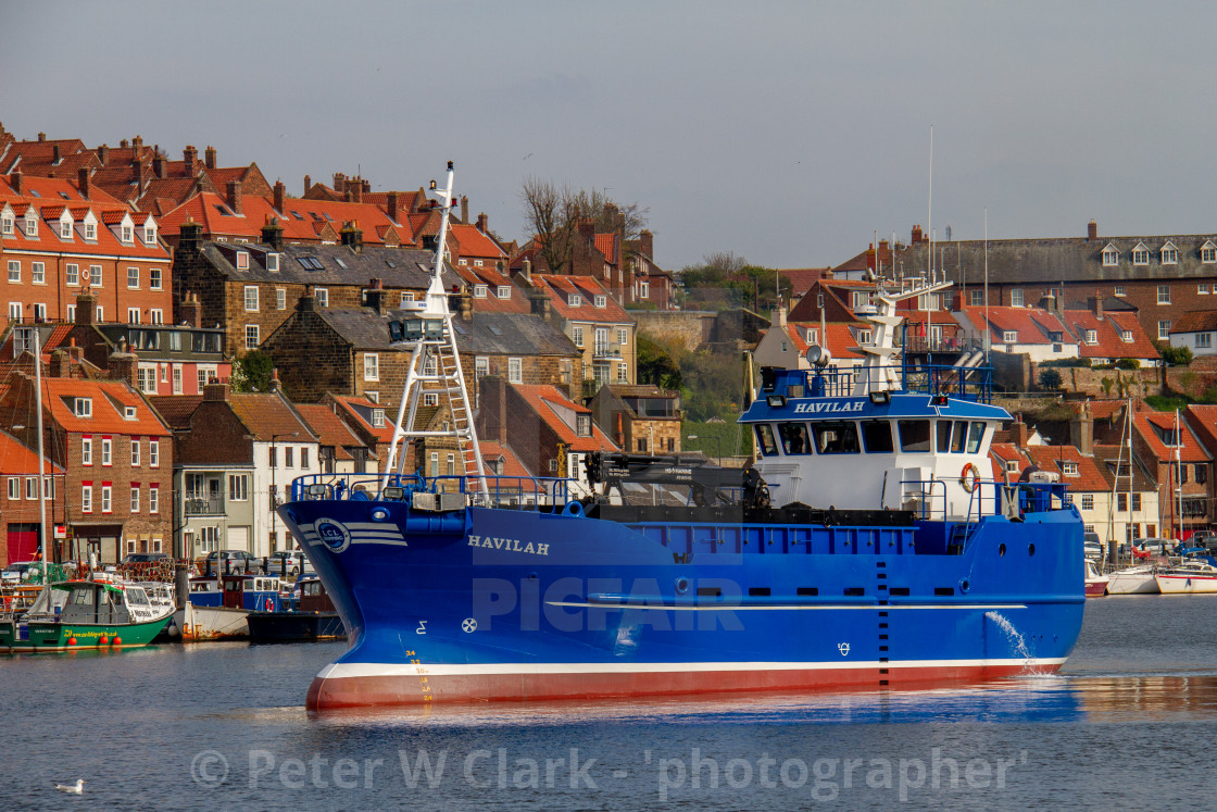 """Havilah a Cargo Vessel Departing Whitby Harbour, a Port on the Yorkshire East Coast."" stock image"