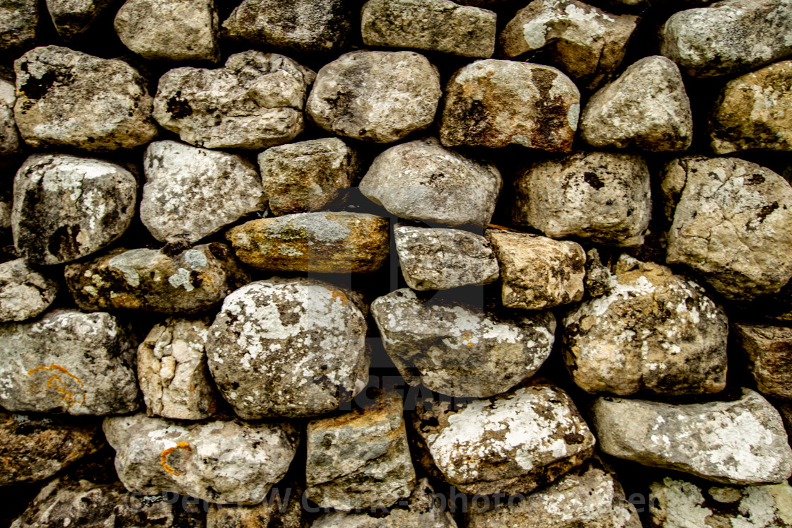 """""""Dry Stone Wall in Kettlewell a Yorkshire Dales Village,"""" stock image"""