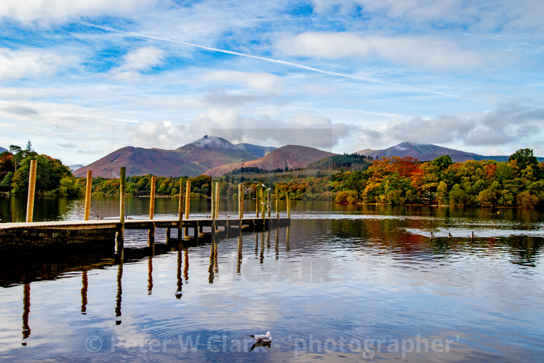 """'Derwentwater Wooden Jetty' and Reflections. Mountains in background. The Lake District, Cumbria, England."" stock image"