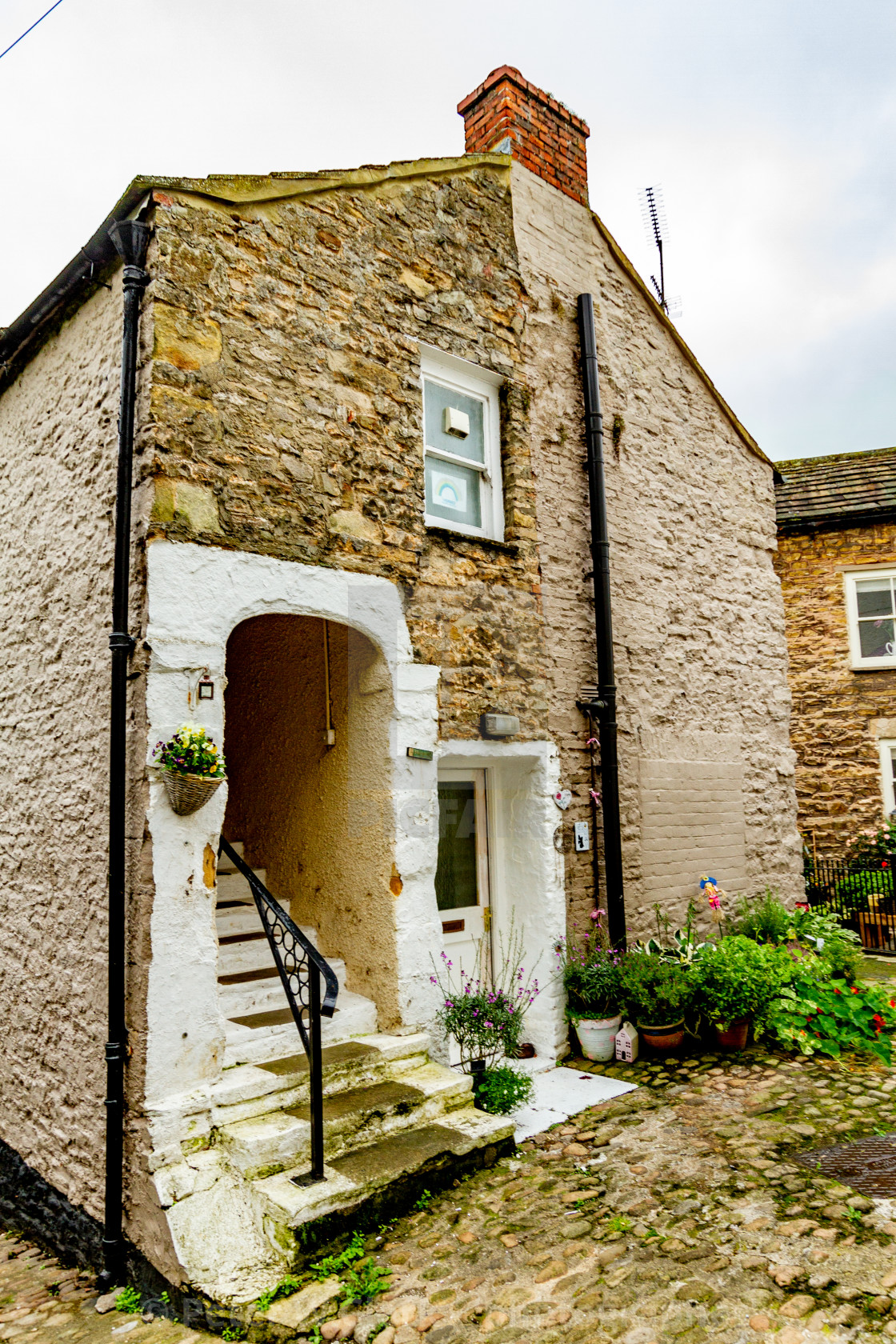 """Picturesque End Terrace Cottage, Richmond, North Yorkshire, England."" stock image"