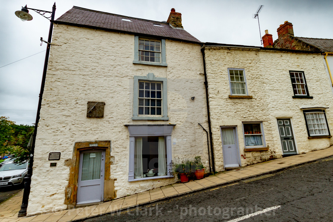 """Richmond, Yorkshire, Bridge Street, East Sundial and Plaque. Sundial Shop."" stock image"
