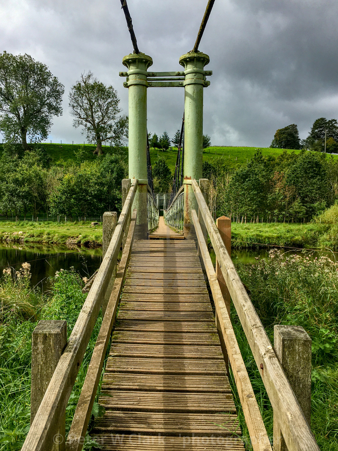 """Burnsall swing bridge, Yorkshire Dales"" stock image"