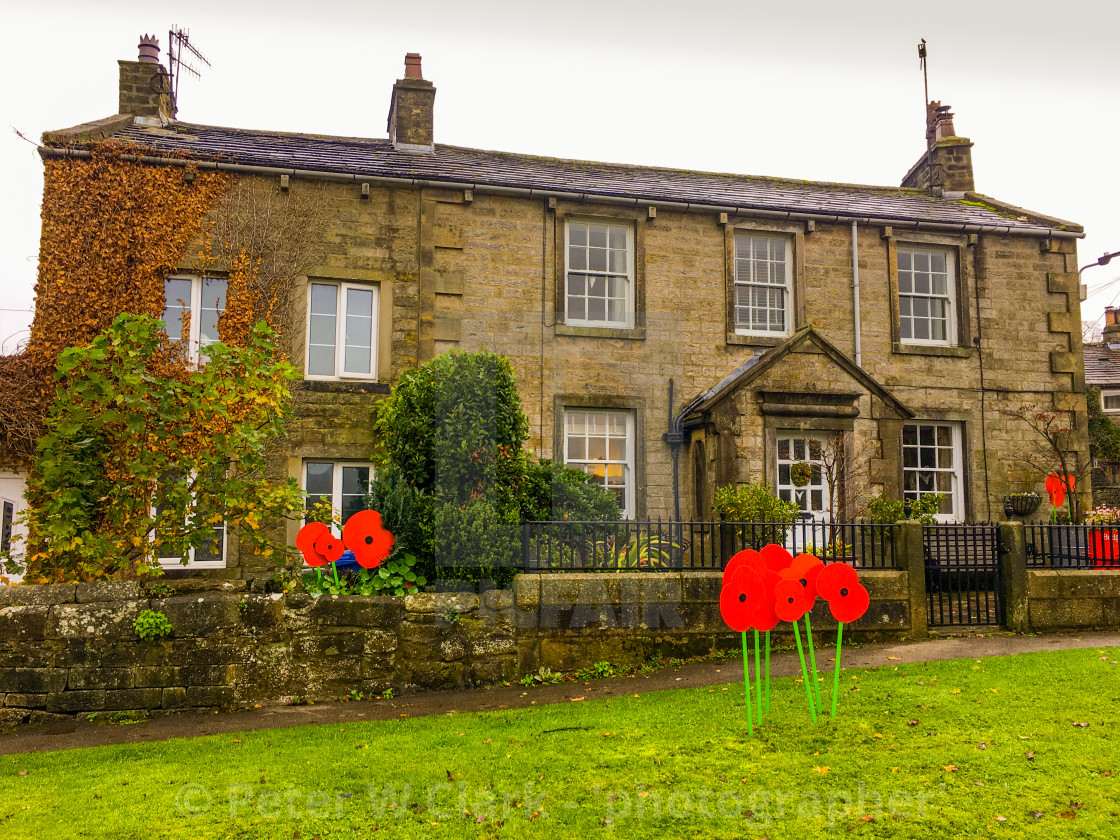"""Burnsall, a Yorkshire Dales Village, Poppy display."" stock image"