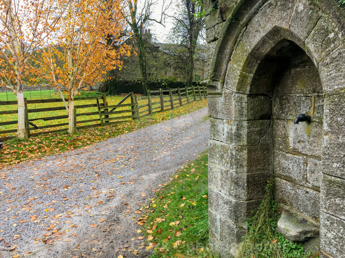 """""""Burnsall, Yorkshire Dales Village, England, Water Compensation Tap."""" stock image"""