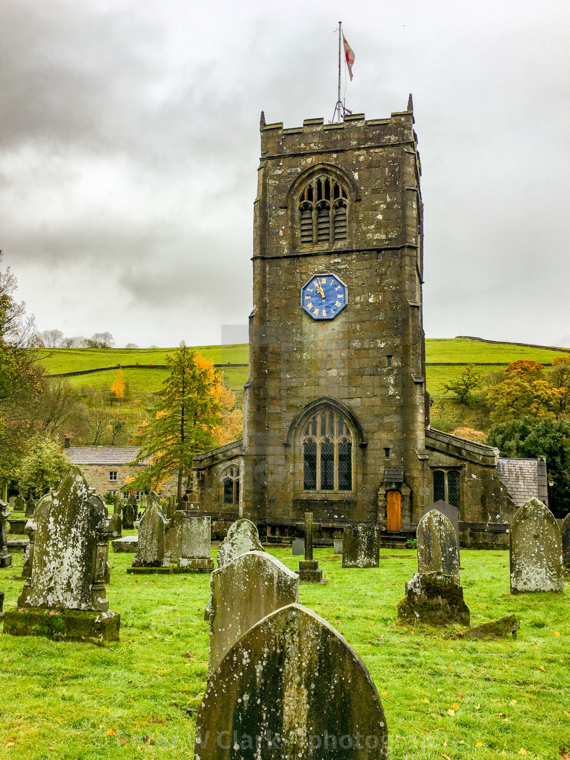 """Burnsall, Yorkshire Dales Village, England, St Wilfrids Parish Church , Clocktower and Graveyard."" stock image"