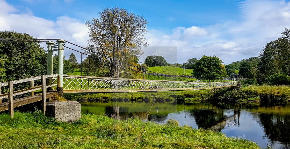"""Hebden Swing Bridge over the River Wharfe. Near Burnsall, Yorkshire."" stock image"