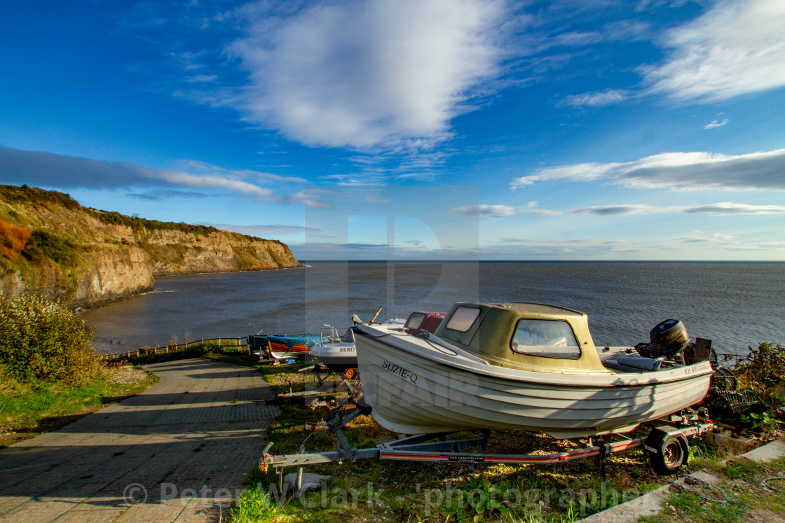 """Small Fishing Boats on Trailers Parked Overlooking Robin Hoods Bay, Yorkshire."" stock image"