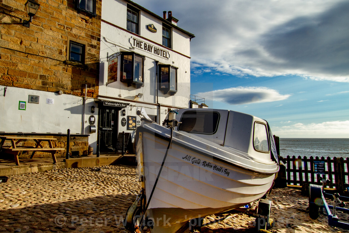 """Robin Hoods Bay, Yorkshire. Fishing boat on trailer in front of The Bay Hotel."" stock image"