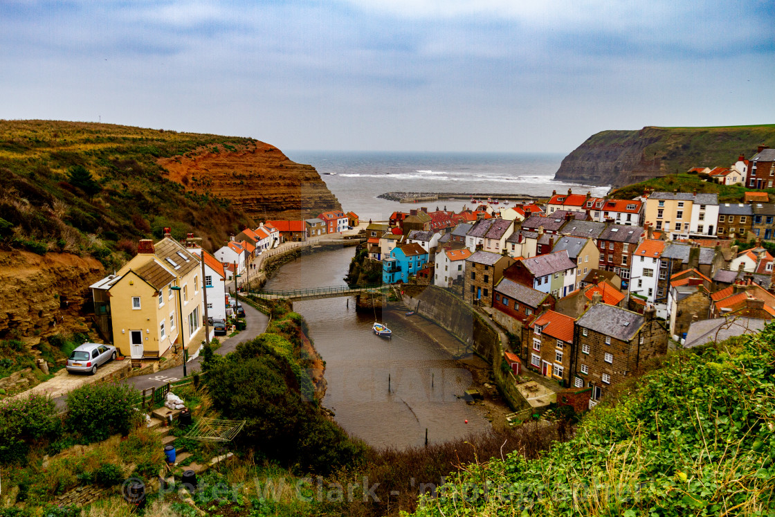 """""""A Panoramic View of Staithes at high tide, Yorkshire East Coast, England."""" stock image"""