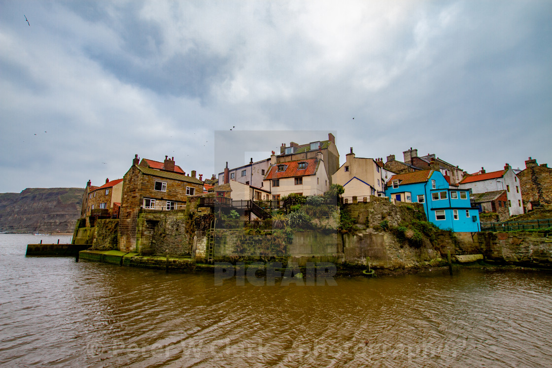 """""""Staithes at high tide, Yorkshire East Coast, England."""" stock image"""
