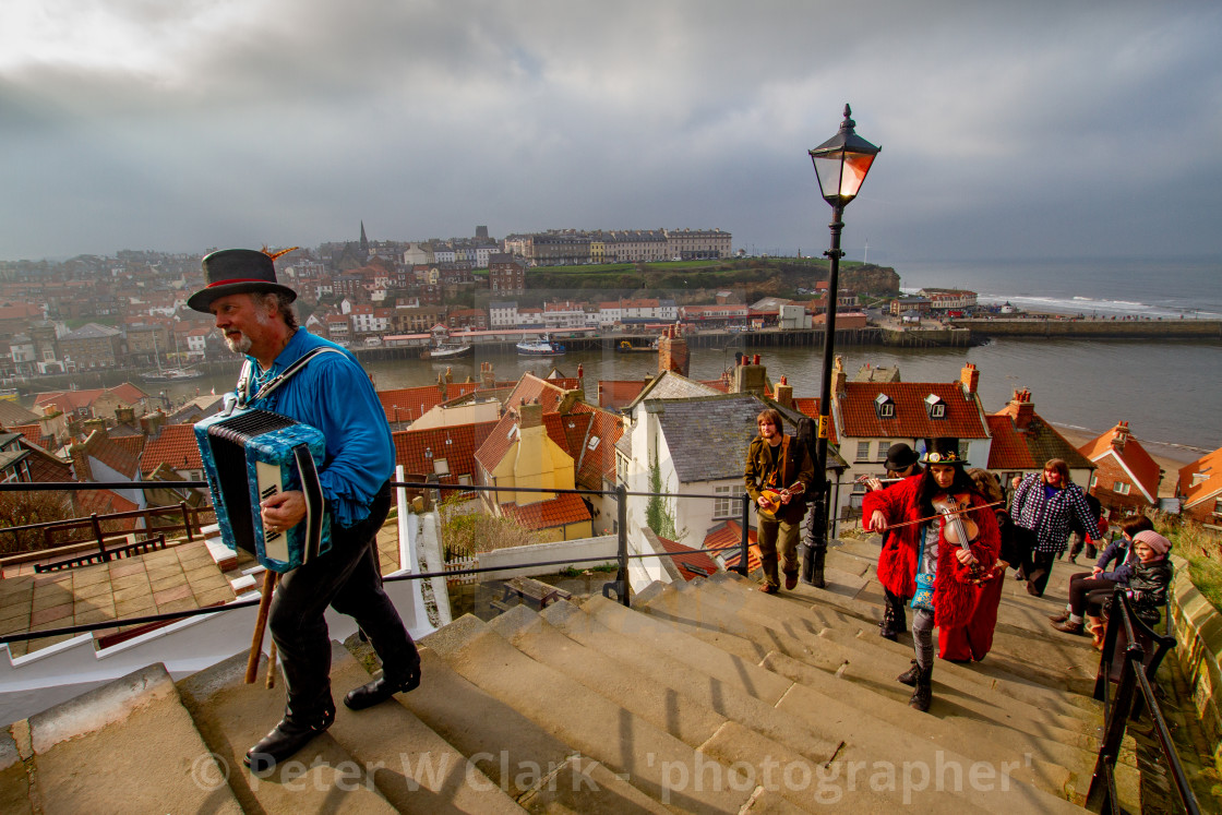 """Folk Musicians Climbing the Whitby Abbey Steps. Yorkshire, England."" stock image"