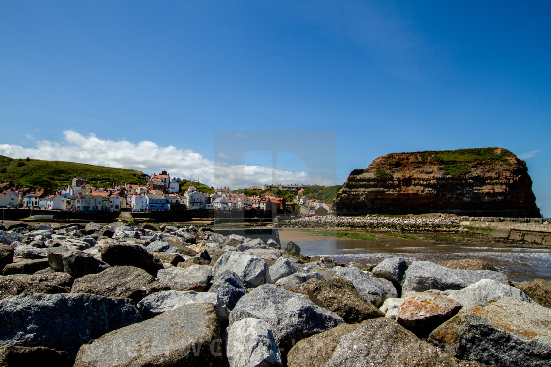 """""""Staithes and Cowbar Nab, Rock Sea Defence to the Foreground. Yorkshire Coast, England."""" stock image"""