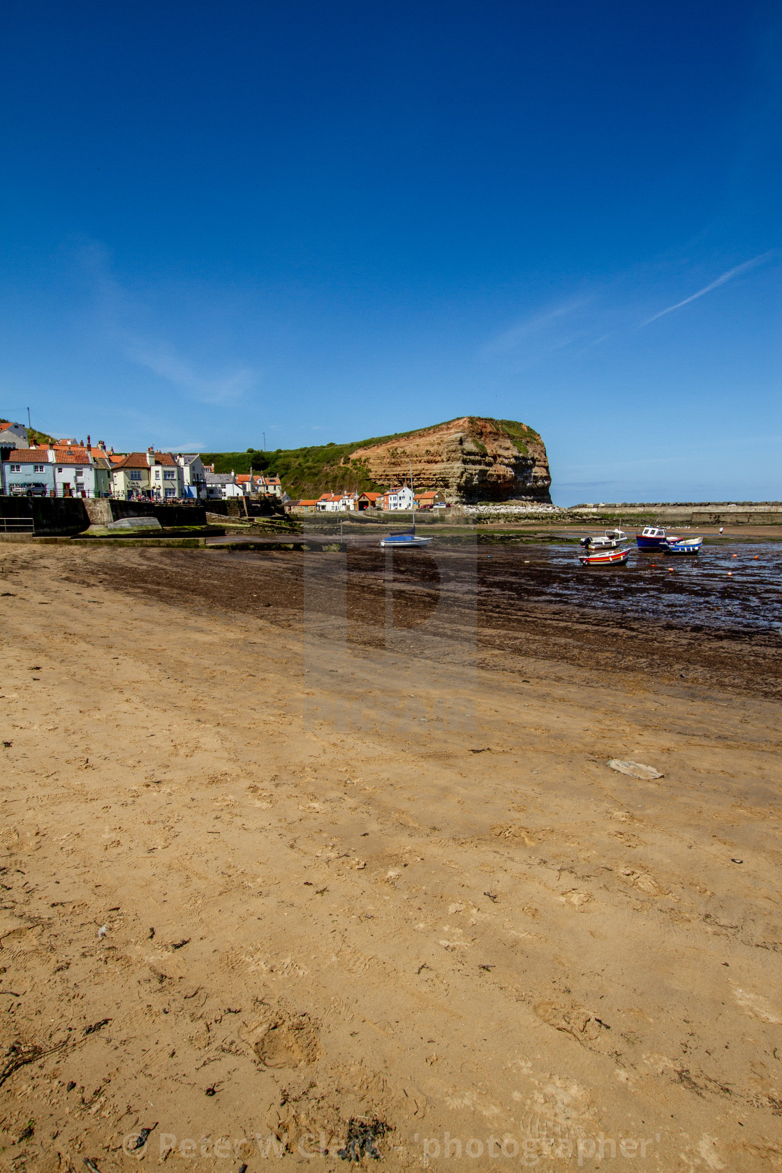 """""""Staithes and Cowbar Nab, Fishing Boats to the Foreground. Yorkshire Coast, England."""" stock image"""