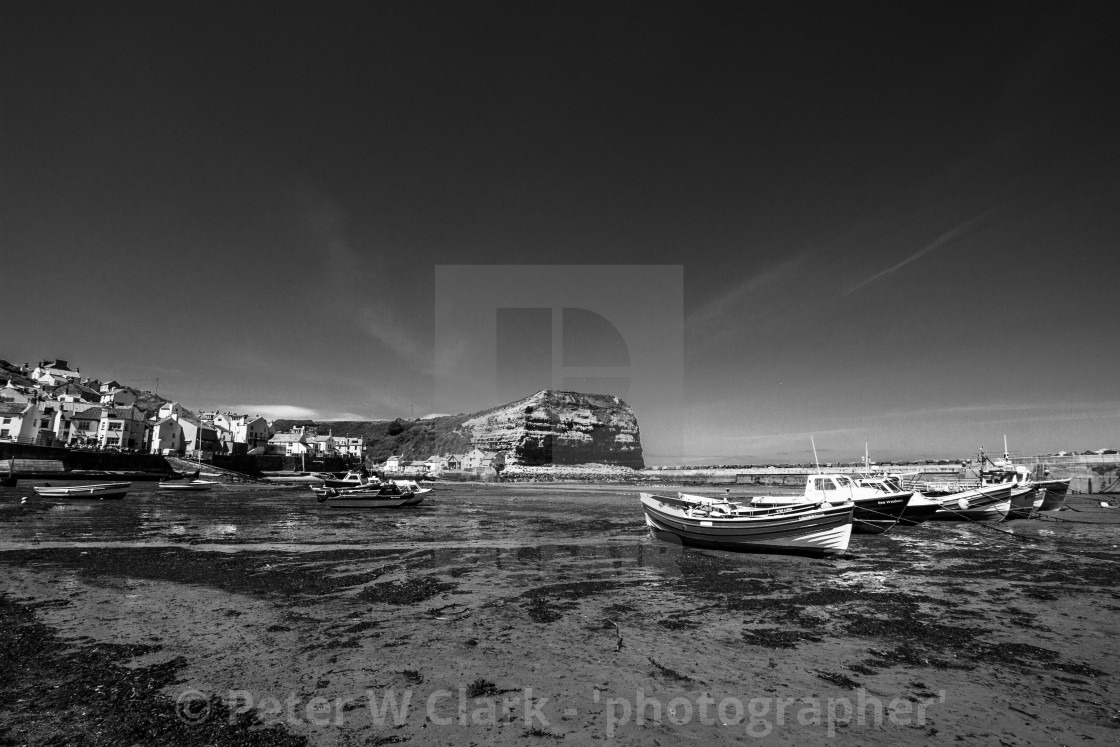 """""""Staithes and Cowbar Nab, Fishing Boats to the Foreground. Yorkshire Coast, England. (monochrome)"""" stock image"""