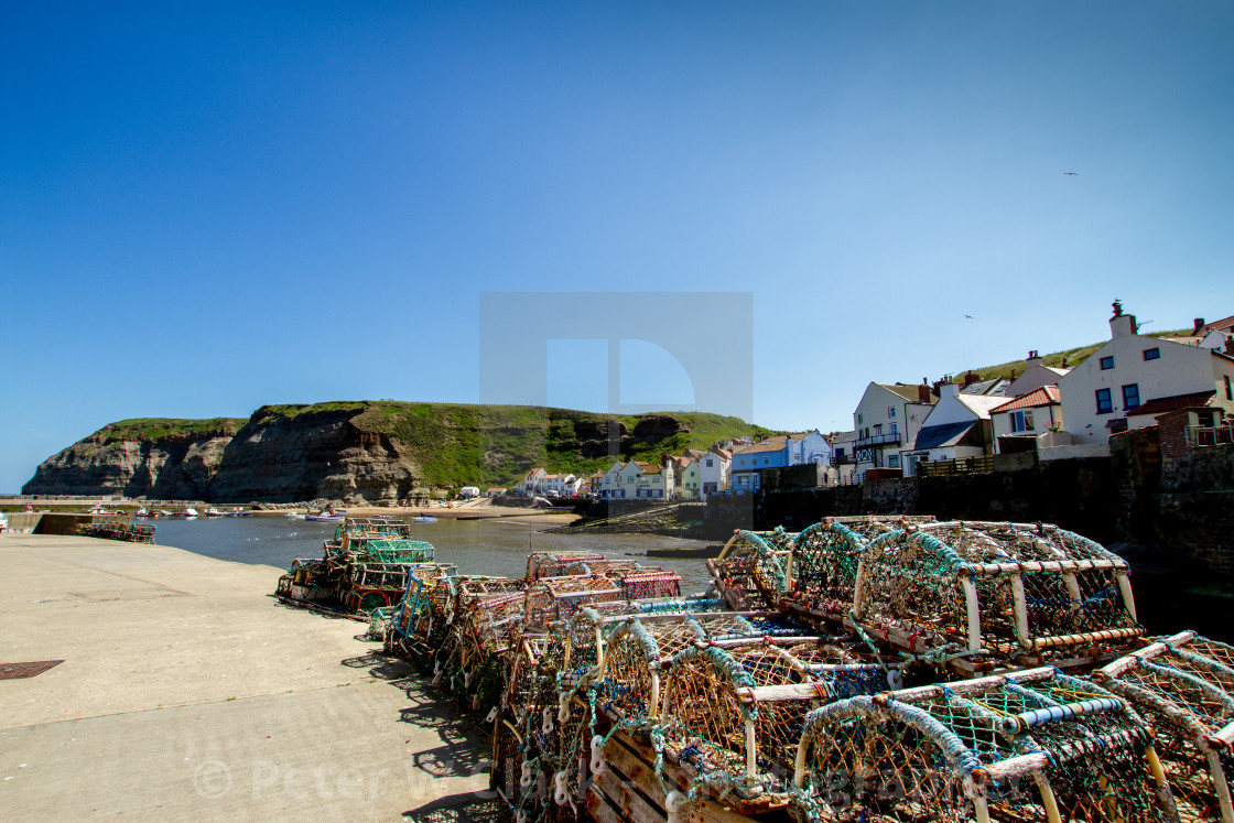 """""""Lobster Pots Stacked on North Side of Staithes Harbour, Yorkshire, England."""" stock image"""