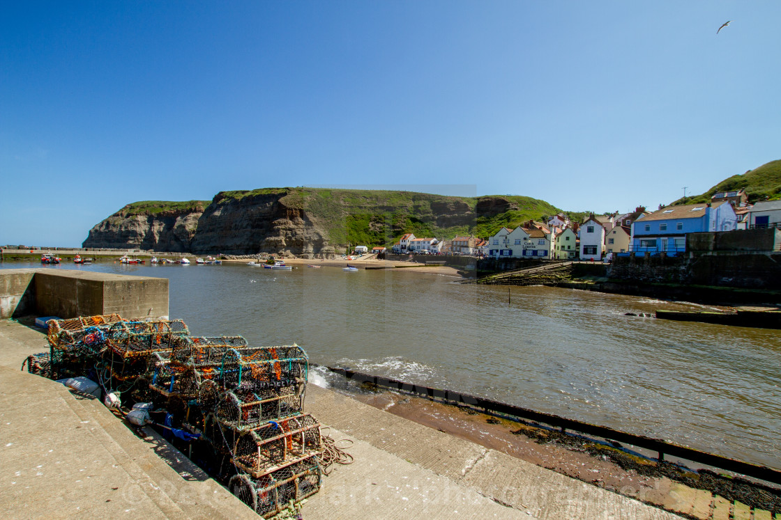 """""""Lobster Pots Stacked next to Slipway on North Side of Staithes Harbour, Yorkshire, England."""" stock image"""