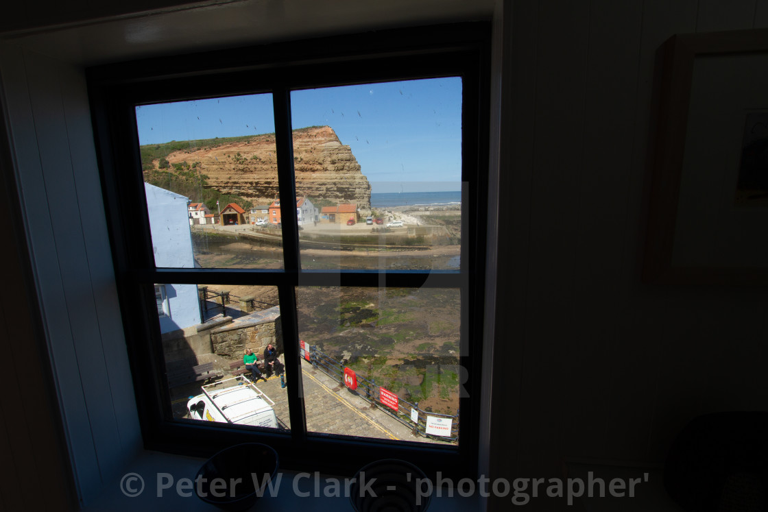 """""""Cod and Lobster Public House, High Street, Staithes, Yorkshire, England. View through First Floor Window. Photographed 03/07/2019"""" stock image"""