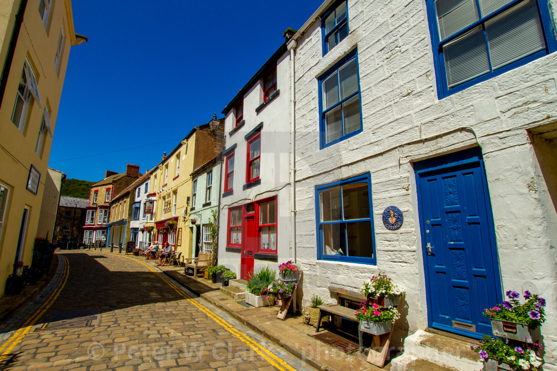 """""""Staithes, High Street Cottages and The Royal George Pub. Yorkshire, England."""" stock image"""