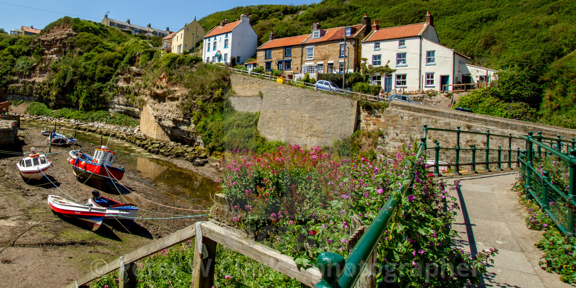 """""""Fishermens Cottages on Cowbar Bank, Moored Cobbles to the Foreground. Staithes, Yorkshire, UK"""" stock image"""