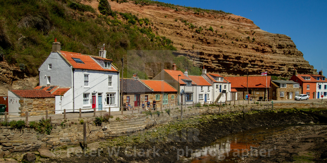 """""""Staithes, Northside, Wharfe, Quay and Fishermens Cottages. Yorkshire, England UK."""" stock image"""