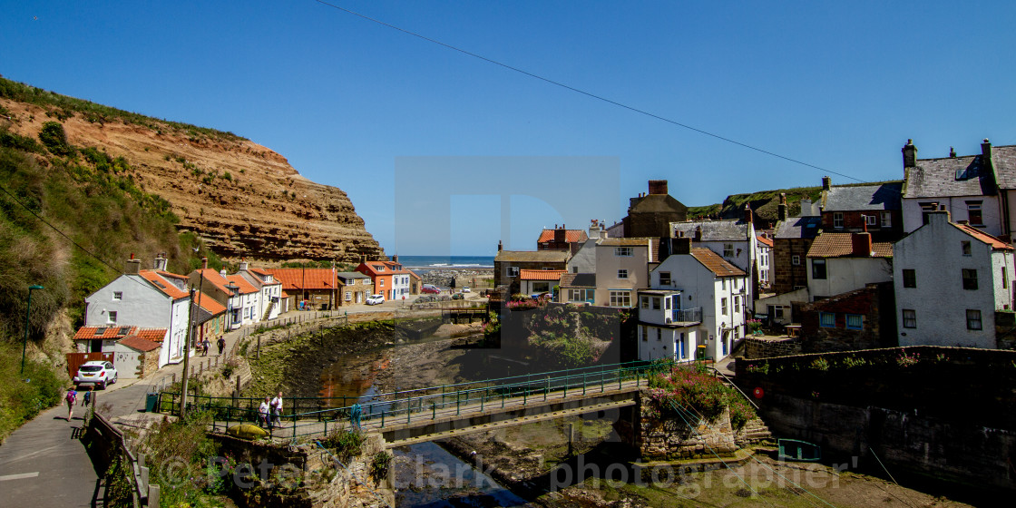 """""""Staithes Footbridge over Staithes Beck, Yorkshire, England."""" stock image"""
