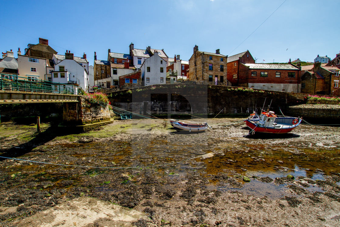 """""""Staithes Footbridge and Moored Fishing Boats in Staithes Beck, Yorkshire, England."""" stock image"""