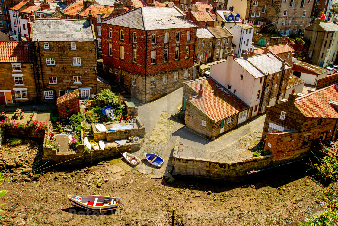 """""""Moored Fishing Boat in Staithes Beck, Slipway and Cottages to the Background. Staithes, Yorkshire, England."""" stock image"""
