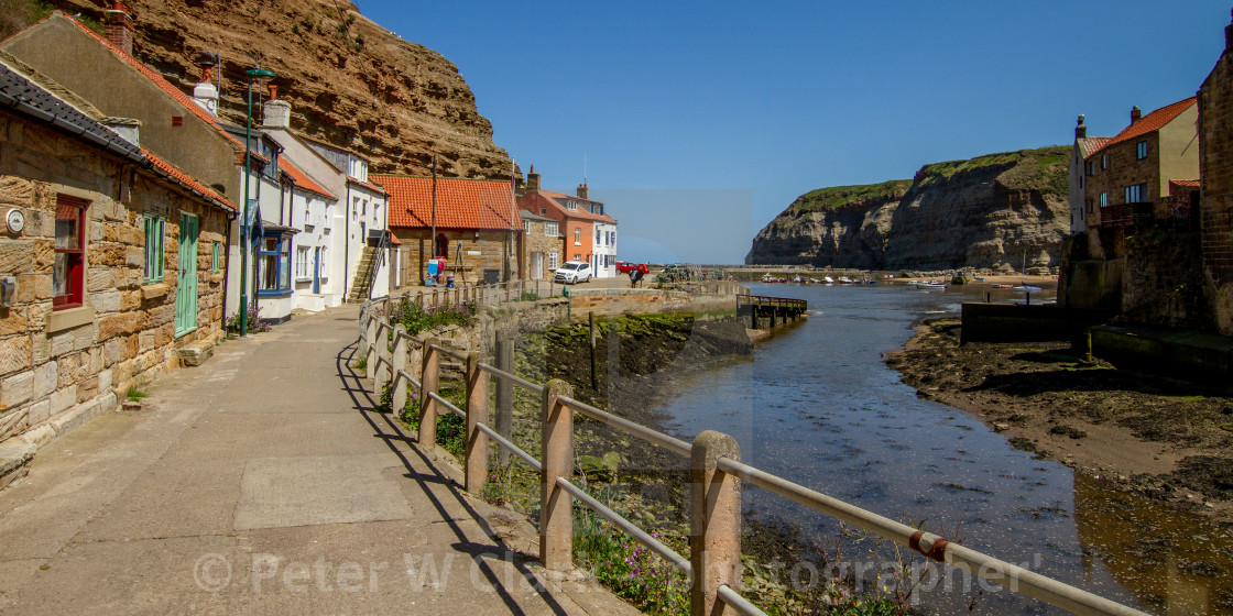 View along Staithes Beck towards North Side Cottages, Cowbar Nab and the Harbour. Yorkshire, England.