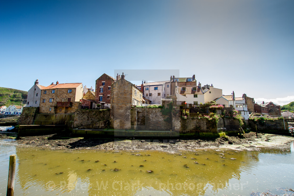 """""""Staithes Cottages on the Harbourside. Yorkshire Coast, England."""" stock image"""