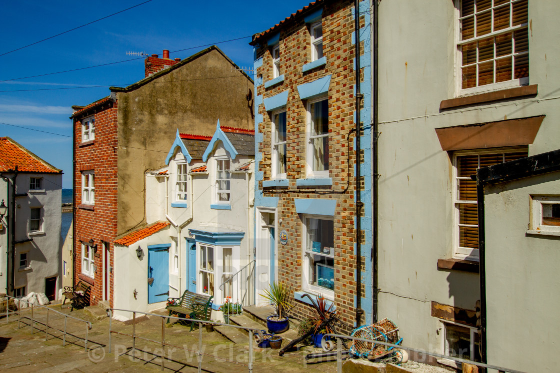 """""""Staithes, High Street Cottages and Houses in Sunshine. Yorkshire, England."""" stock image"""