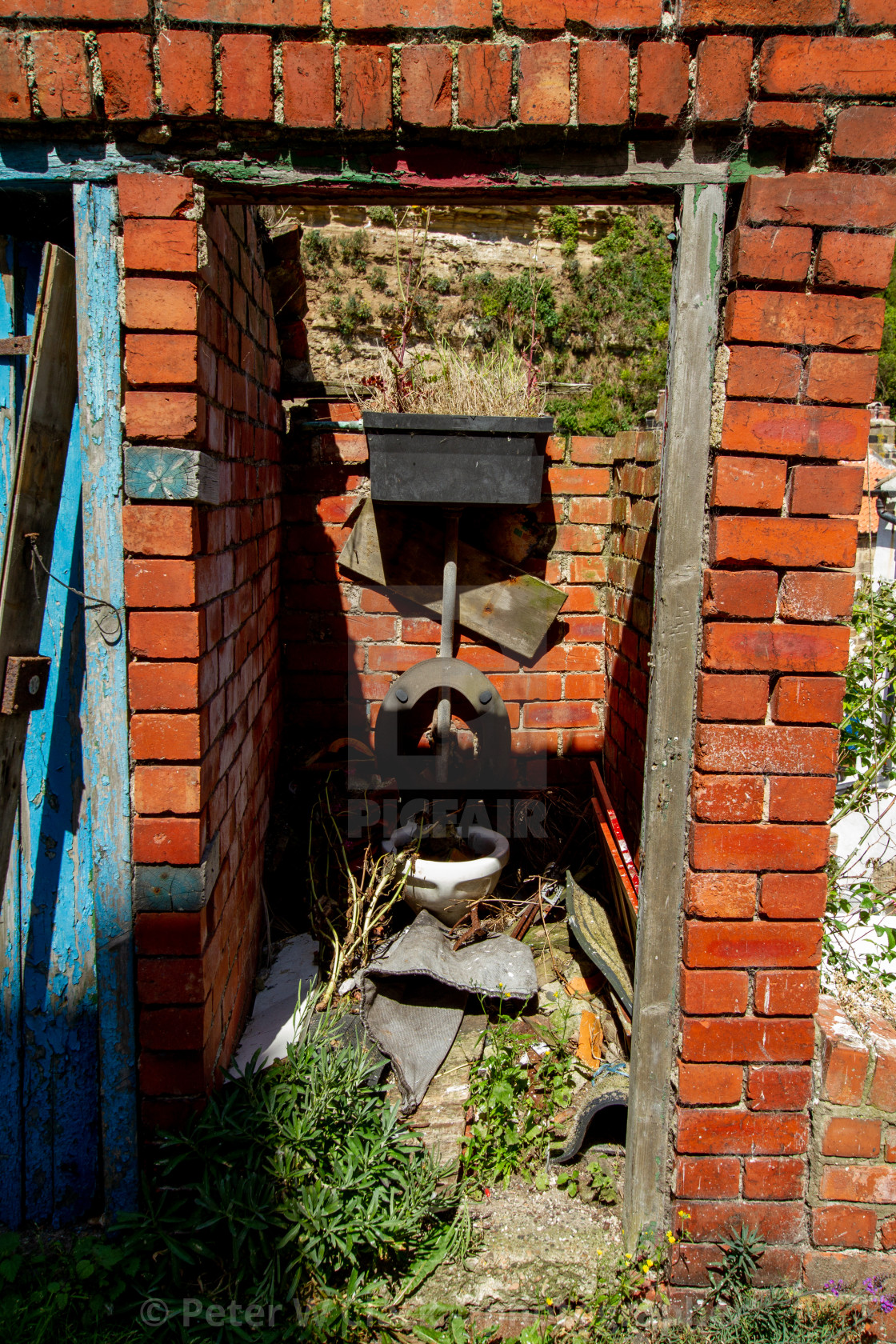 """""""Brick Dilapidated Outside Toilet, Staithes, Yorkshire England."""" stock image"""