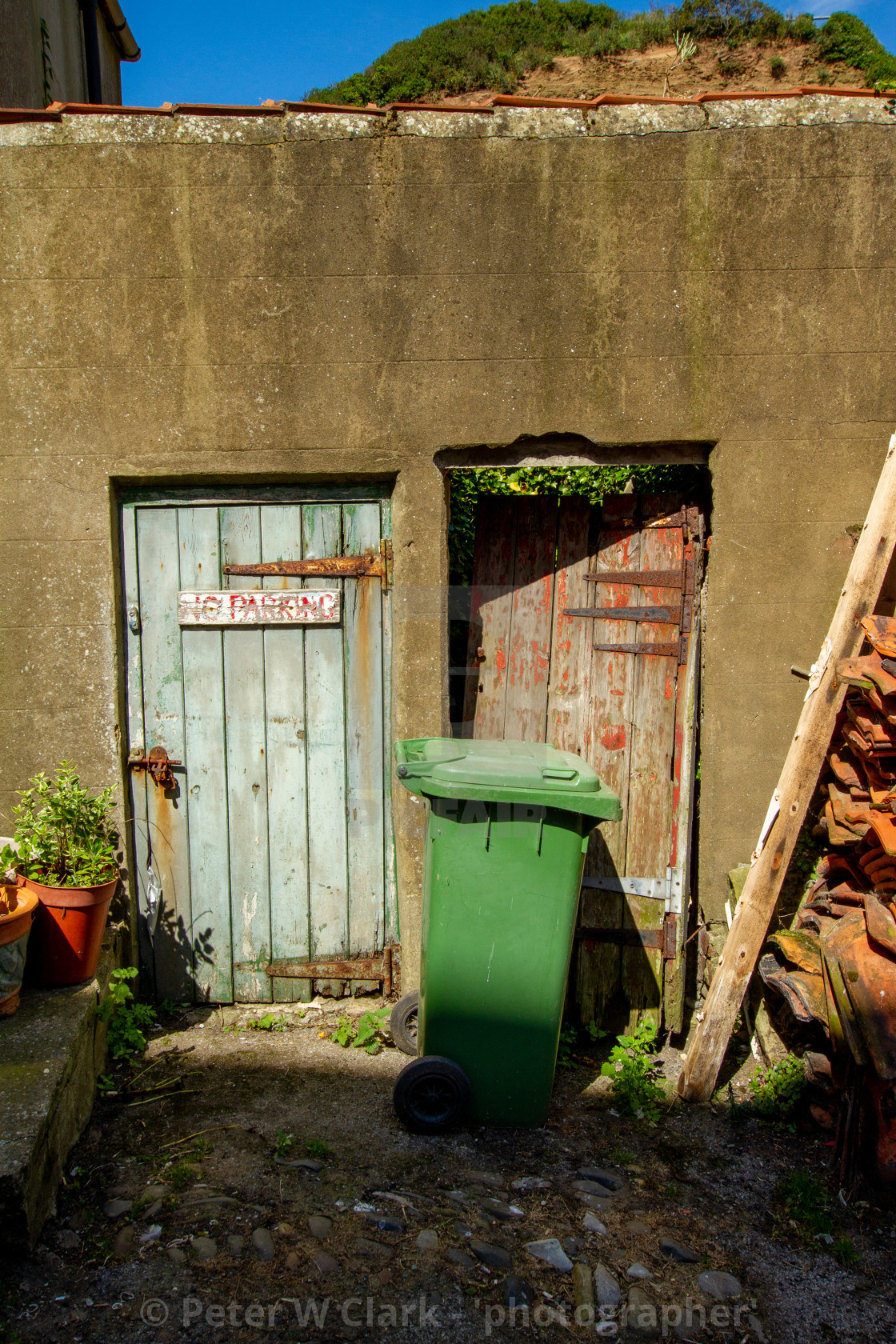 """""""Rendered Dilapidated Outbuildings at rear of cottages. Staithes, Yorkshire England."""" stock image"""