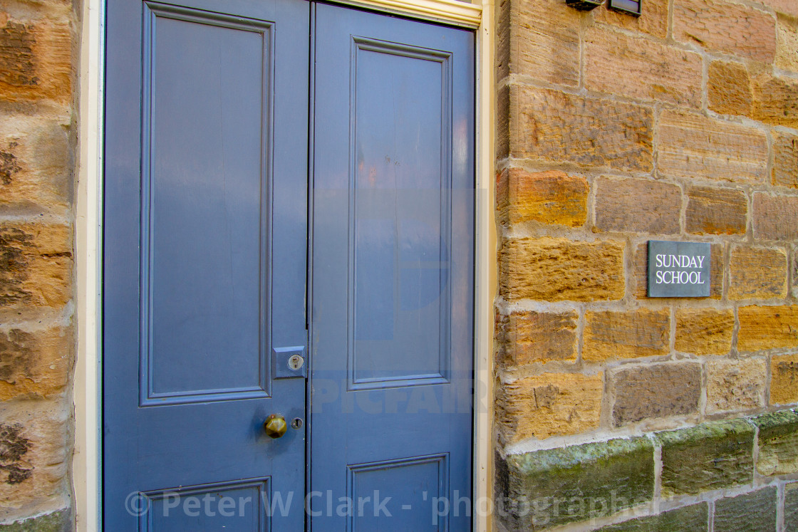 """""""Staithes, Sunday School Sign on Stone Wall, Yorkshire, England"""" stock image"""