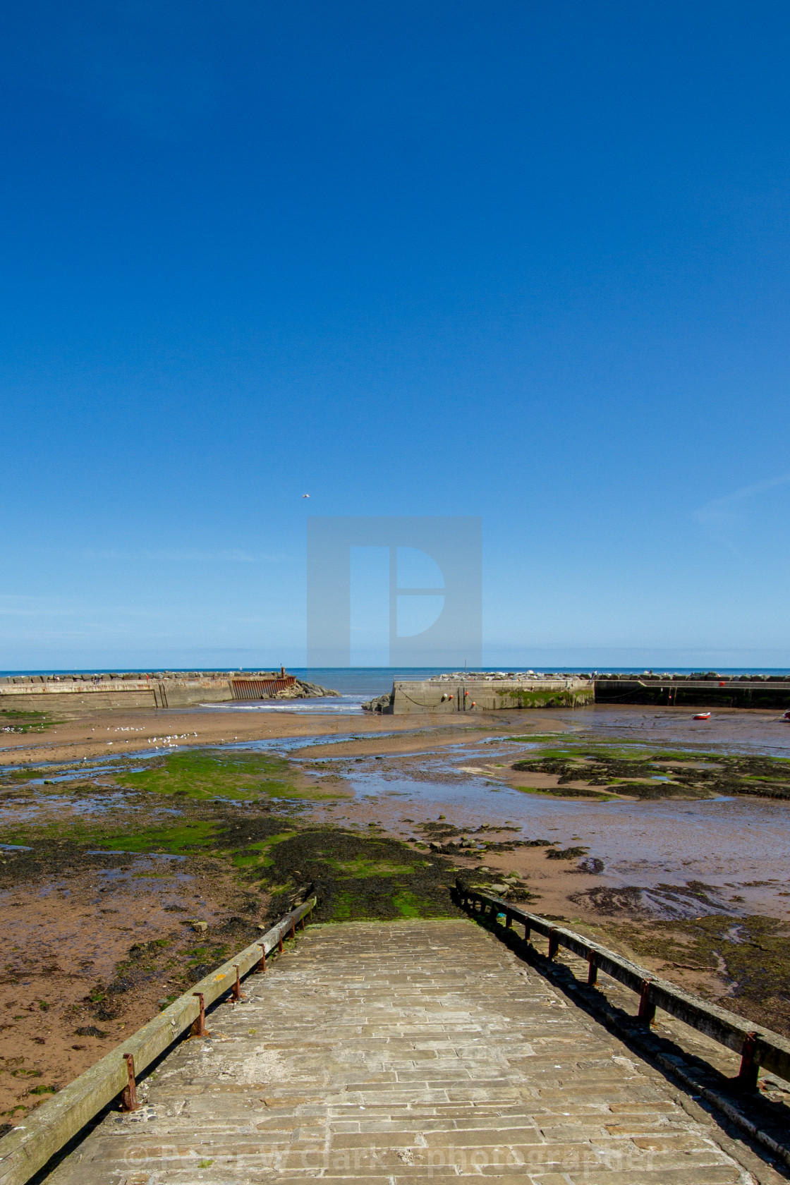 """""""Staithes Harbour at Low Tide, Slipway to the foreground, Yorkshire, England."""" stock image"""