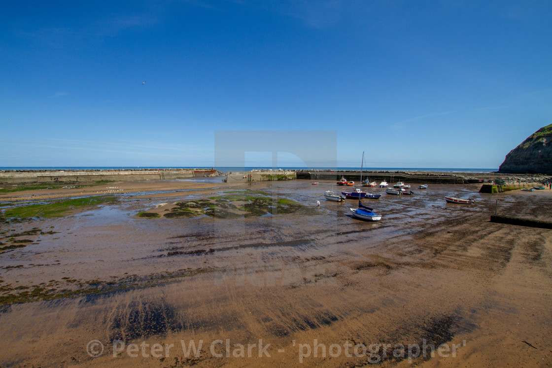 """""""Staithes Harbour at Low Tide, Yorkshire, England."""" stock image"""
